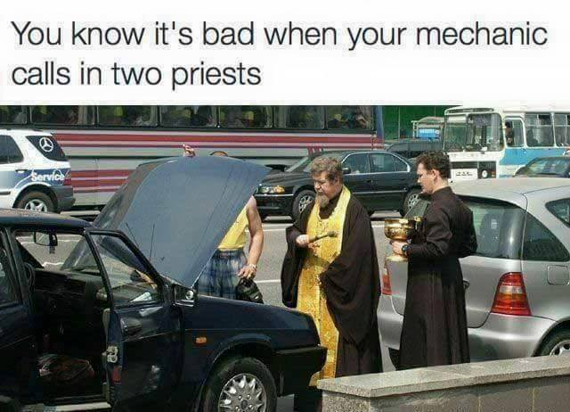 car with two priest.jpg